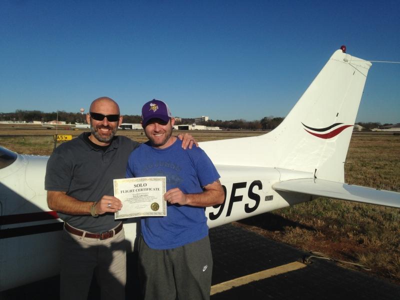 Curt congratulates Eric on his accomplishment