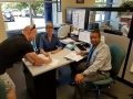 Jamin signs his temporary Private Pilot Certificate with Pilot Examiner Cyndy Hollman and FAA Inspector Dwayne Morrison