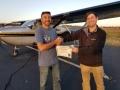 Michael congratulates Nasser on his Commercial Pilot Certificate