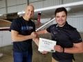 Josh congratulates his student Craig Slater on his achievement