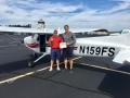 Sam congratulates Ben on his first solo flight